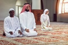Two religious muslim man praying together inside the mosque Royalty Free Stock Photos