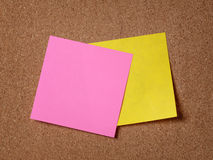 Two reminder sticky notes on cork board Stock Images