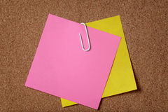 Two reminders sticky note on cork board Stock Image