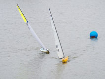 Two remote controlled yachts near buoy. Two remote controlled yachts altering course near the buoy at the competetion Royalty Free Stock Photography