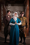 Swordsmen Teasing Nun Royalty Free Stock Photos