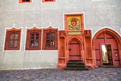 Two Renaissance doorways painted bright coral color with Gothic Royalty Free Stock Photo