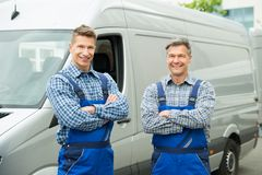 Two Repairmen With Arms Crossed In Front Of Van Stock Images