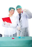 Two researchers with blood tube in laboratory Stock Image