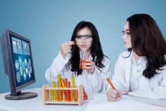 Two researchers doing experiments in the lab Stock Photography