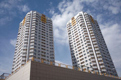 Two residential buildings in a city over blue sky with clouds closeup Royalty Free Stock Image