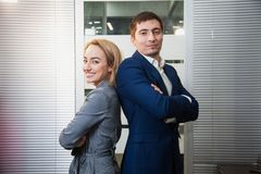 Two respectable business people in formal suits stand together Stock Photo