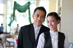 Two restaurant staff at work. With smile stock image