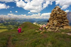 Two resting tourists with Stubai Alps on the background. Dolomites, Italy stock photo