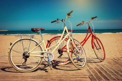 Two retro bicycles on beautiful beach background Stock Photos