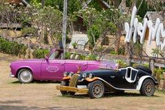 Two retro cars. Pai, Thailand Royalty Free Stock Photos