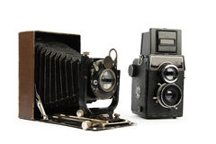 Two retro film cameras. Medium format, isolated on white background Royalty Free Stock Photo