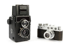 Two retro film cameras. Small and medium format,  on white background Stock Images