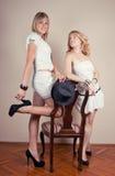 Two retro girl royalty free stock photo