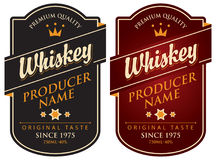 Two retro labels for whiskey in the curly frame Stock Photos
