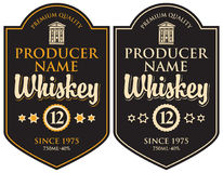 Two retro labels for whiskey in the curly frame Stock Images