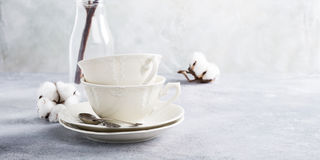 Two retro porcelain tea cups. On light gray background. Copy space Royalty Free Stock Images
