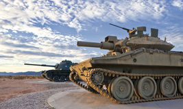 Two Retro Tanks at Sunrise. Two old tanks sit in the desert stock photography