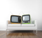 Two retro tv on couch Stock Image