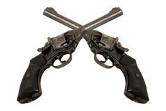 Two revolvers. Two crossed old revolvers.Captured in war Royalty Free Stock Photography