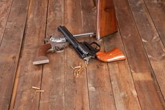 Two Revolvers. With bullets on a wooden background Stock Photography