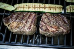 Two Rib Eye Steak With Zucchini On Grill Stock Images