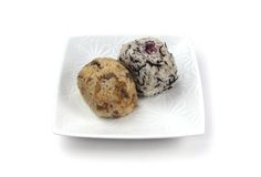 Two rice ball. On the white dish stock photography