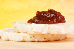 Two rice cakes with jam Stock Images
