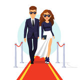 Two rich celebrities walking on a red carpet. Two rich and beautiful celebrities walking on a red carpet. Flat style vector illustration  on white background Royalty Free Stock Photos