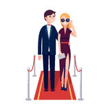 Two rich celebrities walking on a red carpet. Two rich and beautiful celebrities man and woman walking on a red carpet. Modern colorful flat style vector Stock Images