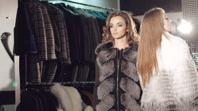 Two rich ladies posing and catwalk in fur coats. Two rich ladies posing and catwalking in fur coats in full HD stock video
