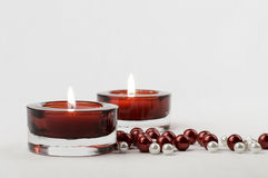 Two rich red candle holder votive and pearls Stock Image