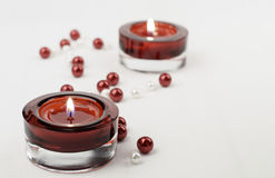 Two rich red candle holder votive and pearls Royalty Free Stock Photo
