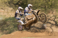 Two riders are jumping a sidecar in the race Royalty Free Stock Photos