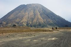 Two riders returning from Batok cone. Near Bromo volcan, in Java, Indonesia Stock Image