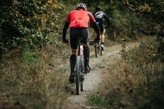Two riders on sport bikes Stock Photos