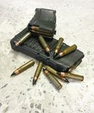 Two rifle mags with bullets on the floor stock photo