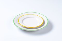 Two rimmed plates Royalty Free Stock Images