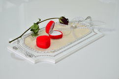Two ring boxes and a rose on a tray. Royalty Free Stock Images