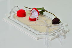 Two ring boxes and a rose on a tray. Stock Photography