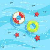 Two Ring Buoys With Blue Sea Water On Background. Beach Vacation Related Illustration Drawn From Above In Simple Vector Cartoon Style Stock Images