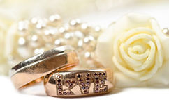 Two rings. And flowers decoration. Studio shot Royalty Free Stock Photo