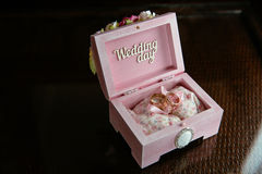 Two rings in a box with Wedding day inscription on dark table. Concept of marriage Stock Photography