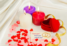 Two rings and a card with marriage proposal Stock Image