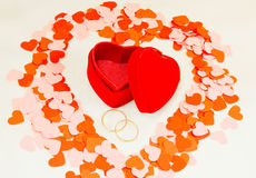 Two rings in front of heart shaped box Stock Photography