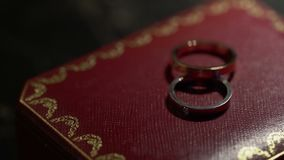 Two rings in a jewelry box. Two rings in a jewelry red box stock footage