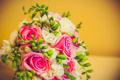 Two rings lie on a bouquet royalty free stock image
