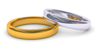 Two rings. One gold and one silver in white background Stock Images