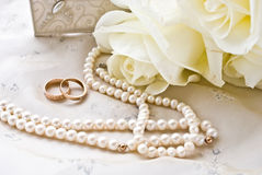 Two rings and pearls Royalty Free Stock Images
