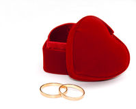 Two rings and red box. Two rings and heart shaped red box Stock Photo